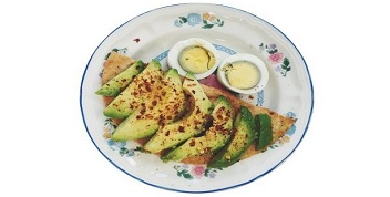 Avocado fritter, served with garlic sauce, avocado and boiled egg slices