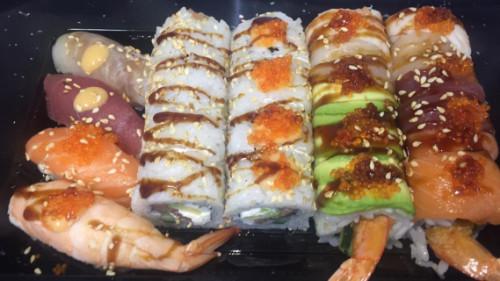 Rainbow 8, california roll 4, salmon classic 4, nigiri 4