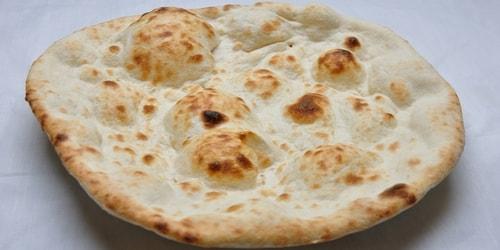 Pite me miell të bardhë e pjekur në furrë balte
